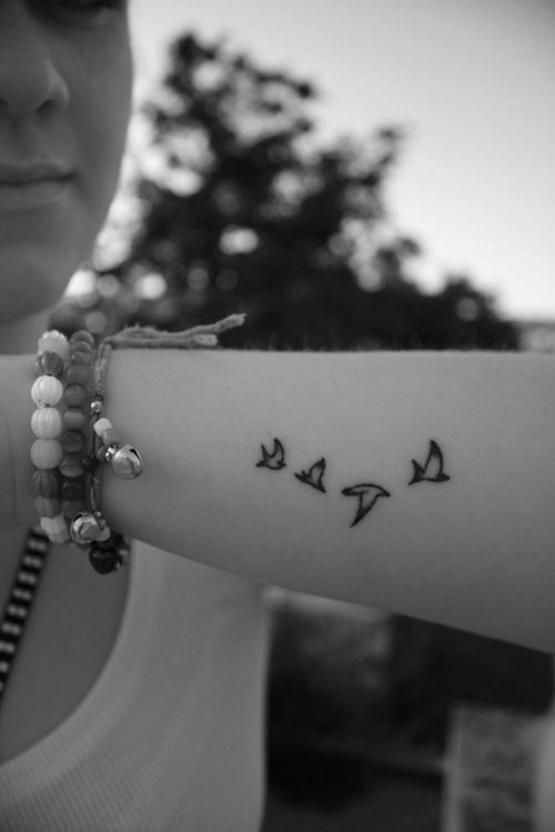 Pretty small bird tattoo