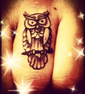 Pretty stars and owl tattoo on finger