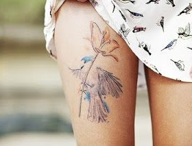 Pretty women flower and bird tattoo on leg