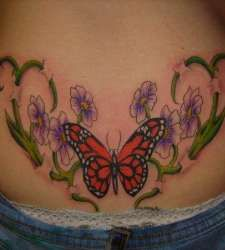 Purpel flowers and red butterfly tattooo