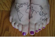 Purple nails and map tattoo on legs