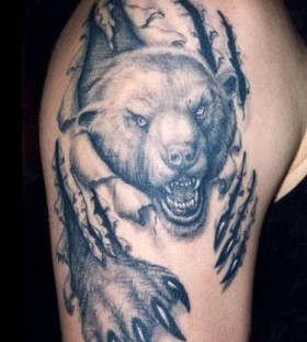 Realistic black bear tattoo on arm