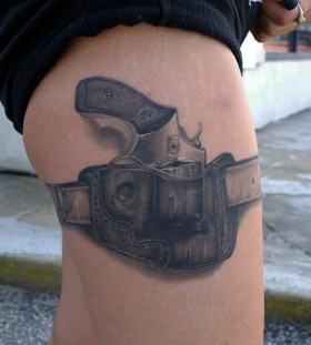 Realistic black gun tattoo