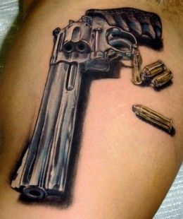 Realistic dark blue gun tattoo