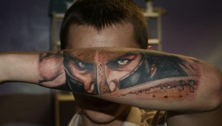 Realistic soldier face tattoo on arm