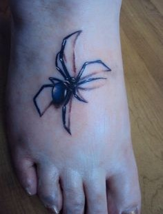 Realistic spider tattoo on foot