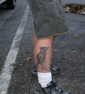 Realistic wolf and wolf tattoo on leg