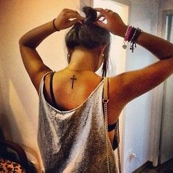 Really simple back cross tattoo
