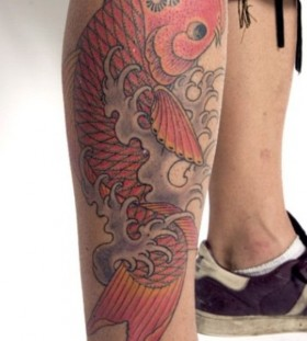 Red adorable fish tattoo on leg