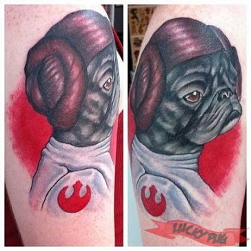 Red and black dog tattoo on arm