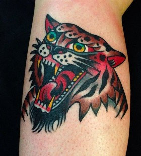 Red and brown tiger tattoo on arm