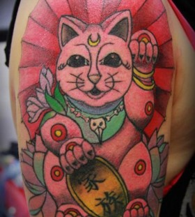 Red awesome cat tattoo on arm