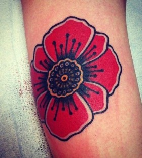 Red awesome poppy tattoo on leg