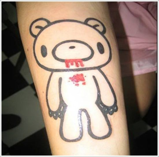 Red blood and black bear tattoo on arm