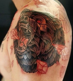 Red crystals and bear tattoo on shoulder