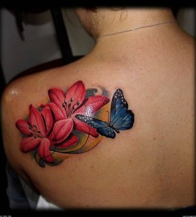 Red flowers and butterfly tattoo on shoulder