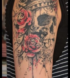Red flowers and skull tattoo on shoulder