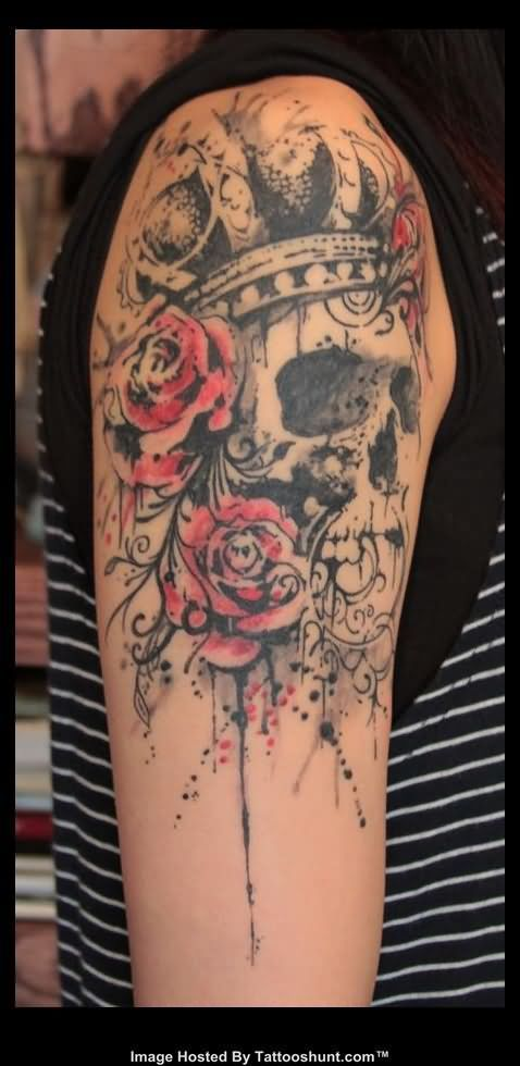 Red flowers and skull tattoo on shoulder TattooMagz