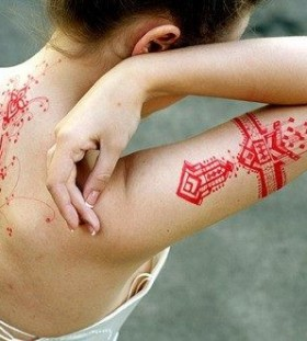 Red girl lace tattoo on arm