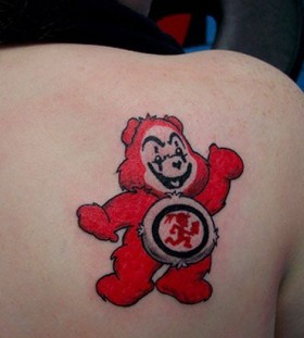 Red lovely bear tattoo on shoulder