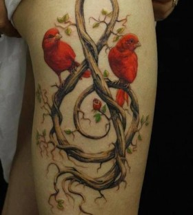 Red lovely bird tattoo on leg