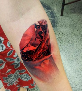 Red lovely crystal tattoo on leg
