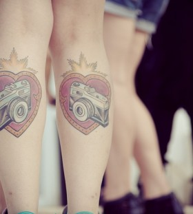 Red lovely heart camera tattoo on leg