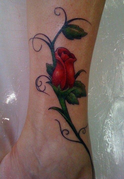 Red lovely rose tattoo on leg