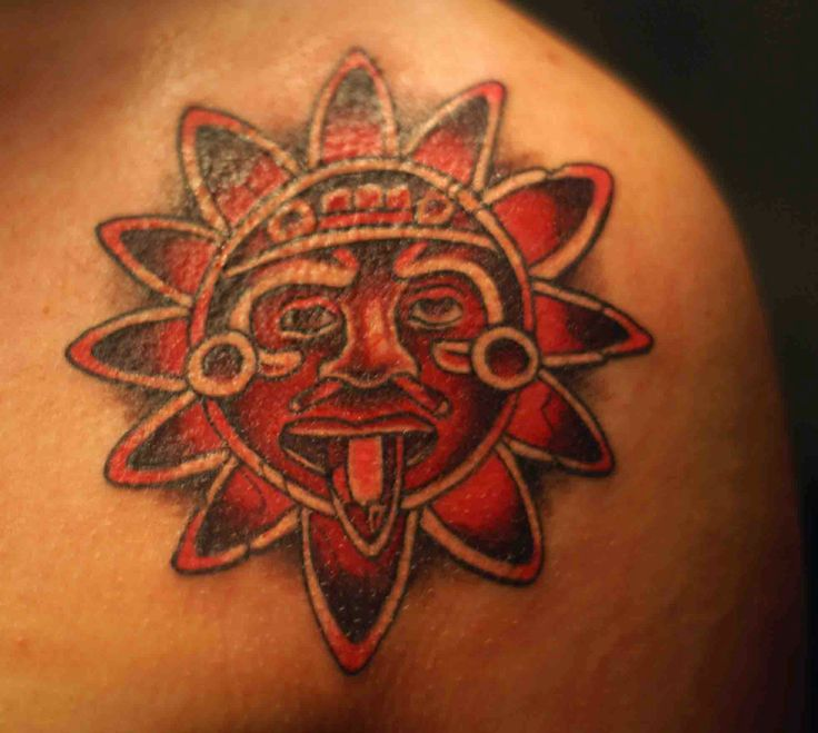 Red lovely sun tattoo on shoulder