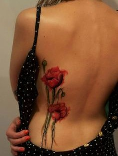 Red poppy watercolor tattoo on girl back
