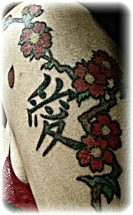 Red pretty cherry tattoo on arm