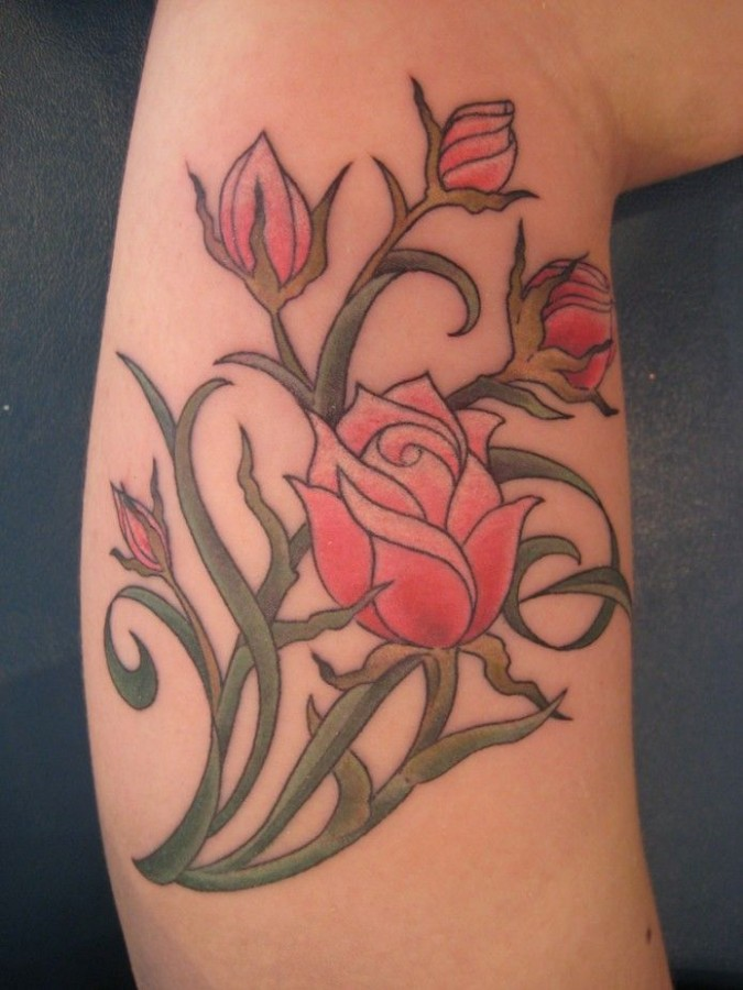 Red pretty rose tattoo on arm