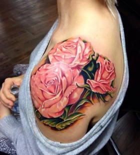 Red pretty roses tattoo on shoulder