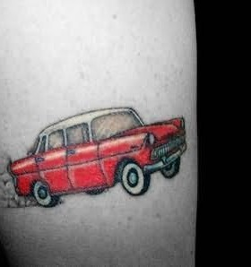Red pretty small car tattoo on arm