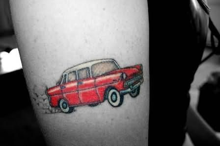 Red pretty small car tattoo on arm