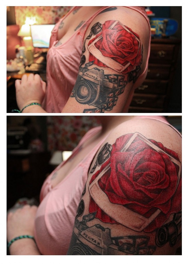 Red rose and pentax camera tattoo on arm