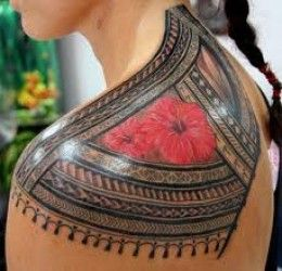 Red rose and tribal tattoo on shoulder