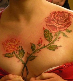 Red rose flower tattoo on chest