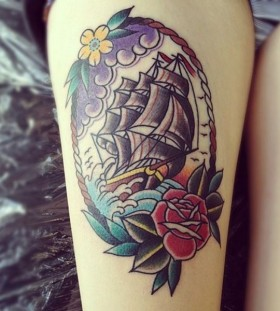 Red rose ship tattoo on leg