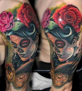 Red rose, women and skull tattoo on arm