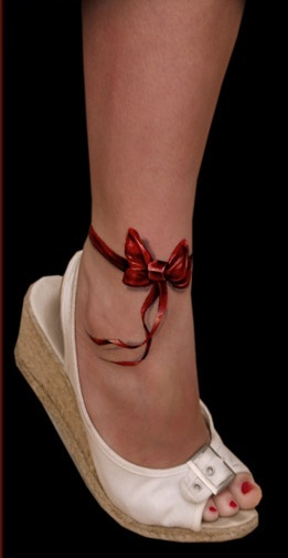 Red simple bow tattoo with shoes