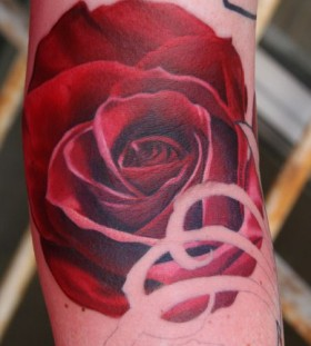 Red simple rose tattoo on arm