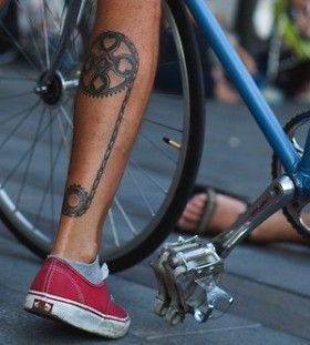 Red trainers and bicycle tattoo on leg