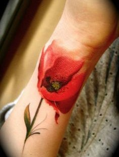 Red tulip tattoo on hand