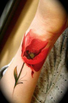 Red tulip tattoo on hand