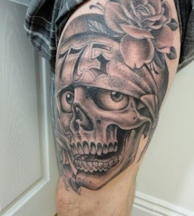 Rose and funny skull tattoo on leg
