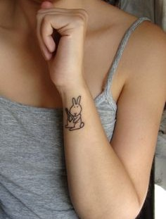 SImple black rabbit tattoo on body