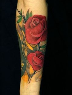 SImple red rose tattoo on arm
