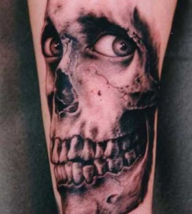 Scary great skull tattoo on arm