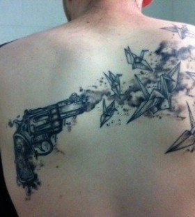 Scary gun and birds origami tattoo on shoulder